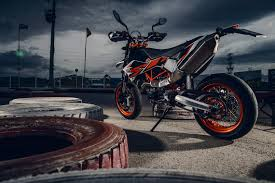 brake test in front of police ktm smc r 690 motorcycles