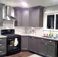 grey cabinets black appliances silver hardware tile