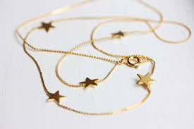 necklace with star images Gold star necklace long gold star necklace star charm jpg