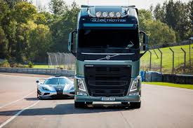 a volvo fh challenges one of the world u0027s fastest sports cars u2013 a