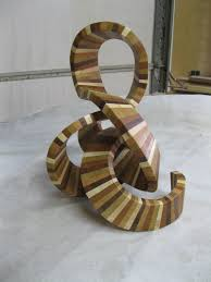 modern wood abstract sculpture titled by countywoodworking