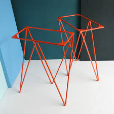a pair of zigzag trestle table legs powder coated in orange the