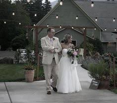 wedding venues vancouver wa groom in a field of dandelions at cape horn estate