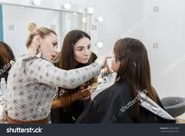 become a professional makeup artist professional makeup student stock photo