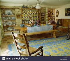 rocking chair and blue yellow rug in french country dining room