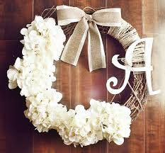 monogrammed white hydrangea grapevine wreath with a satin
