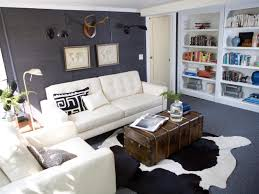 interior white tufted sofa and cowhide rugs plus grey area rug