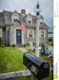 classic cape cod house with stars and stripes editorial photo