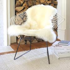 fur chair cover wonderful 112 best sheepskin rugs throws images on home