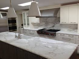 Kitchen Countertop Materials by A Remodeled Kitchen With A Slab Of Granite Island Matching