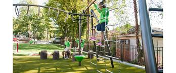 climbers challenge park playground with double slide and spinning