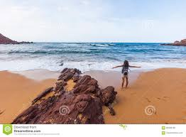 young expressing her feeling of freedom in a volcanic beach