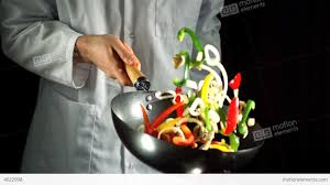 cuisiner wok chef tossing vegetable stir fry in wok stock 4022098