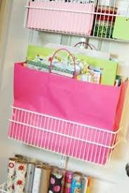 how to store wrapping paper and gift bags 28 easy storage ideas for small spaces wrapping paper storage