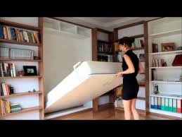 sliding bookcase murphy bed wall bed folded behind sliding bookshelves youtube