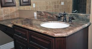 tuscan bathroom with wooden vanities with granite countertops and