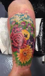 jade baxter smith start of a flower garden half sleeve tattoo