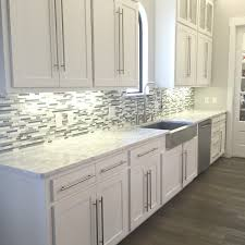 white kitchen with backsplash a kitchen backsplash transformation a design decision