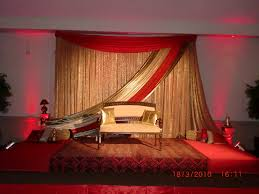 wedding backdrop ottawa non symmetrical design with bronze gold and fabric swag