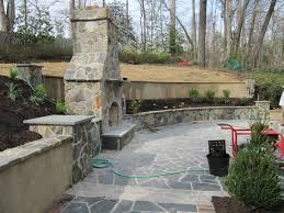 remarkable stone outdoor fireplace coupled with retaining wall