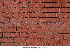 red brick wall texture with thick mortar grout stock photo