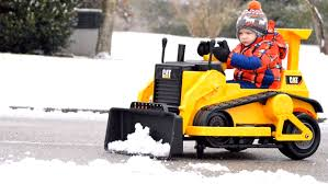3 year old boy gets rid of neighborhood snow one driveway at a