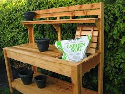 Garden Table Plastic Soft Brown Light Wood Potting Table With Some Black Plastic Pot