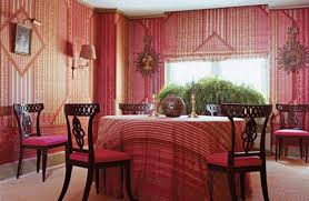 moroccan dining room with wallpaper and striped tablecloth