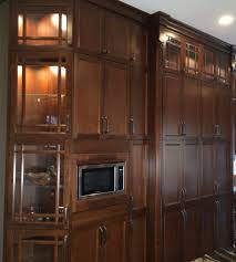 should kitchen cabinets go to the ceiling space above kitchen