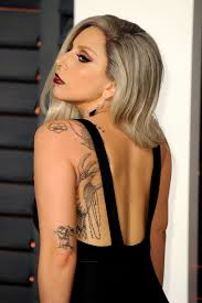 lady gaga tattoos meanings explained billboard