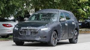 maserati levante wallpaper maserati levante spied could be hiding a coupe like roofline