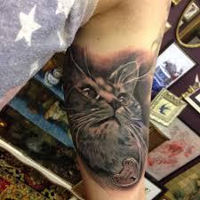 cat on inner arm by klaus tattooer rose tattoo gallery devon