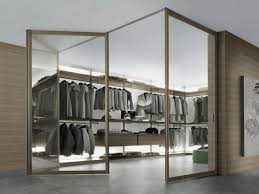 contemporary glass walk in closet idea for men with folding glass