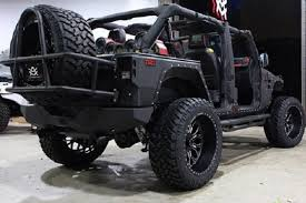 jeep custom wheels replaces burnt jeep with sinister looking custom wrangler