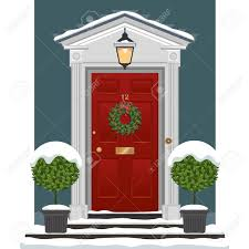 red painted front door with christmas wreath in the snow royalty