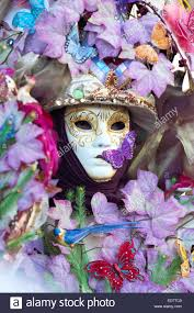 mask decorations a pink and violet mask with floral decorations exhibited during