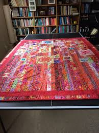 gypsy wife quilt made with kaffe fassett jelly roll and squares