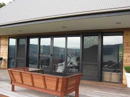 Secure French Doors - double brown wooden patio doors with black metal handles and