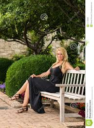 blonde woman sitting on bench fashion stock photo image 41742698