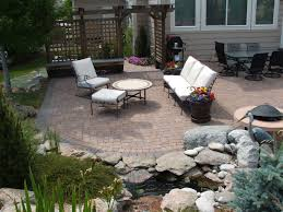 minimalist patio with fire pit and pavers patio pavers can add