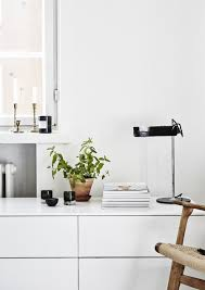 helsinki apartment displays scandinavian design at its finest view in gallery a hint of green gold and black for the beautiful apartment living room