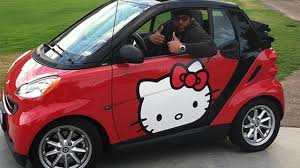 smart car pink nfl star rolls around in a hello kitty fortwo