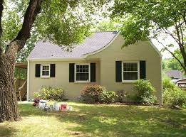 tan yellow with black shutters painted brick houses pinterest