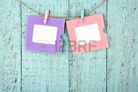 four empty colorful photo frames or notes paper hanging with