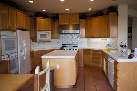 how to finish the top of kitchen cabinets how to paint wood finish kitchen cabinets functionalities net