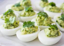 deviled eggs serving dish guacamole deviled eggs avocado deviled eggs simplyrecipes