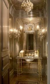 elegant half bath design with console sink and mirror and