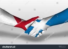 handshake between scotland england flags painted stock photo