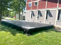 large stage with skirting and our beer trailer in the background