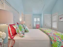red and blue girls room with white hanging rattan chair in nook